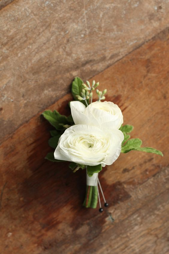 2 white ranunculus blooms for the grrom