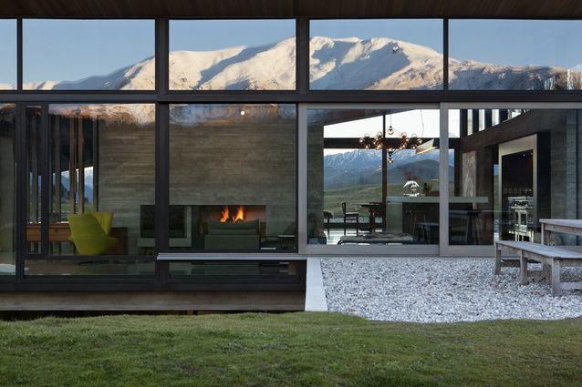 Expansive windows afford views over the alpine landscape.