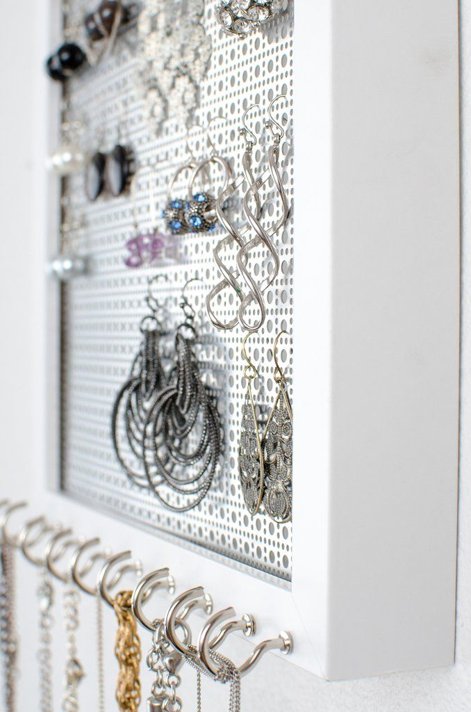 Organize your Hook Earrings & Necklaces I've created the BEST 2-n-1 Jewelry Organizer. This 8x10 Solid White Frame holds all your Hook Earrings & Necklaces. It hangs on the wall to provide the perfect