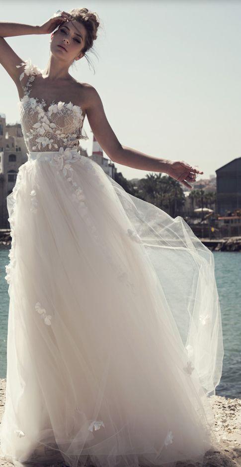 Glamorous one-shoulder floral applique tulle skirt wedding dress; Featured Dress: A&J Designers