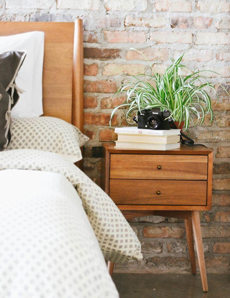 Exposed brick loft + houseplant + @westelm's Mid-Century Side Table