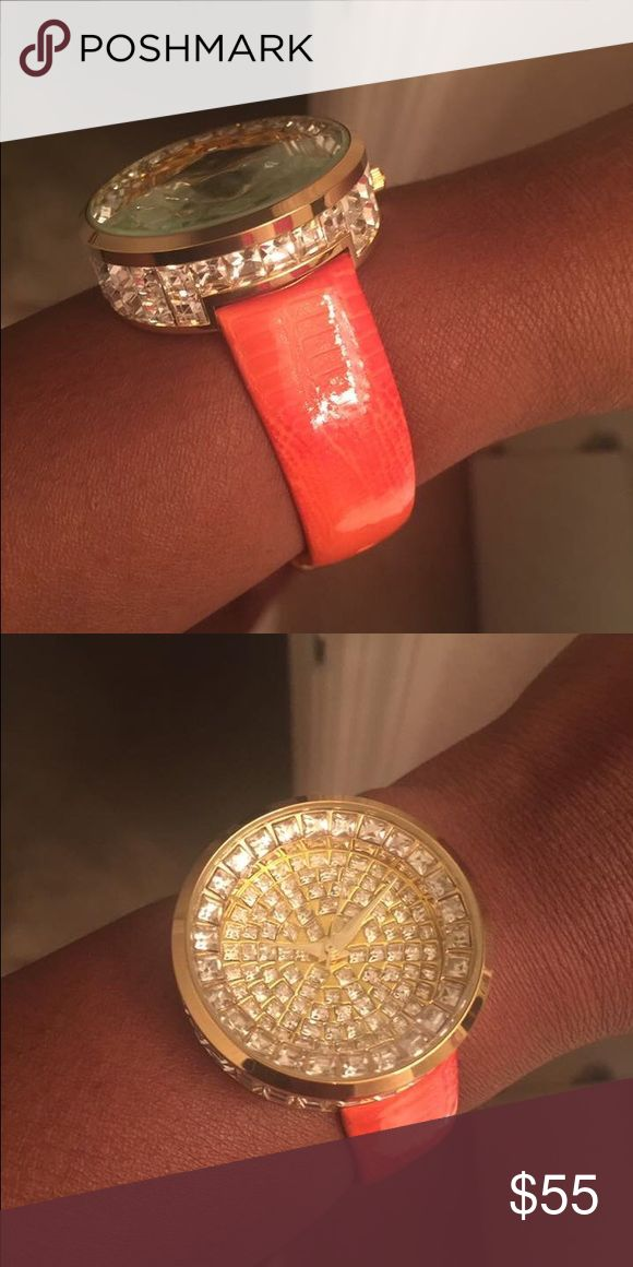 Orange Watch Big face watch with Bling all around the sides. Watch still has full battery. One of a kind. Get lots of attention when you walk in a room on time or fashionably late. Rare find. No missing pieces. Traci Lynn Accessories Watches