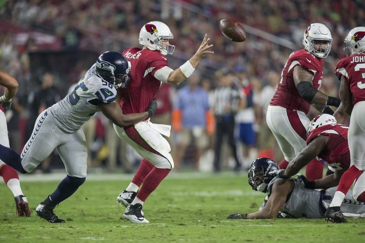 Seahawks tie the Cardinals, 6-6, in OT  -  October 23, 2016:     Seattle Seahawks defensive end Cliff Avril (56) gets to Arizona Cardinals quarterback Carson Palmer (3) in the second quarter. (Dean Rutz / The Seattle Times)