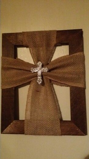 burlap cross with small glitter cross wrapped around a picture frame