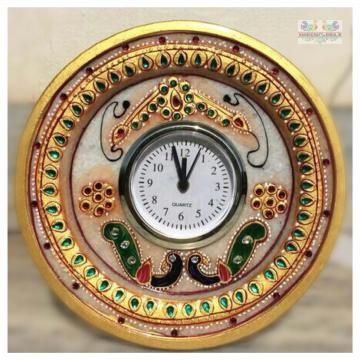Gold Embossed round Alarm Clock. Artifact is jewelled with Meenakari and Kundan work - A masterpiece in marble! Adorned with subtle stokes of gold work to add brilliance to your home decor.