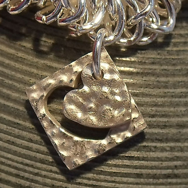 In & Out of Love Silver Charm