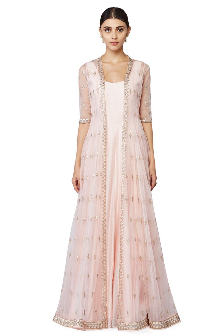 A beautiful composition of intricately placed gota buttis in a pastel peach net jacket paired with a solid peach gown inside. INR 89,000.00