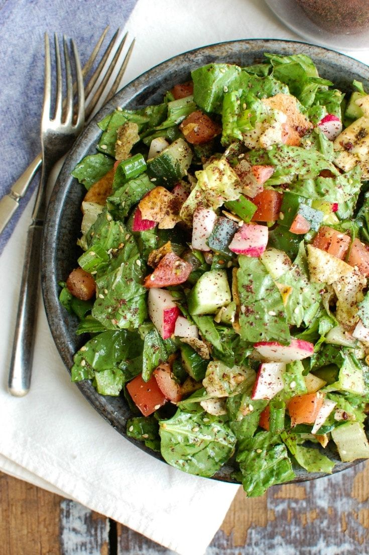 A healthy Middle Eastern Salad with a light, lemony vinaigrette dressing. This salad mixes crisp romaine, fresh vegetables, pita chips and lemony dressing.