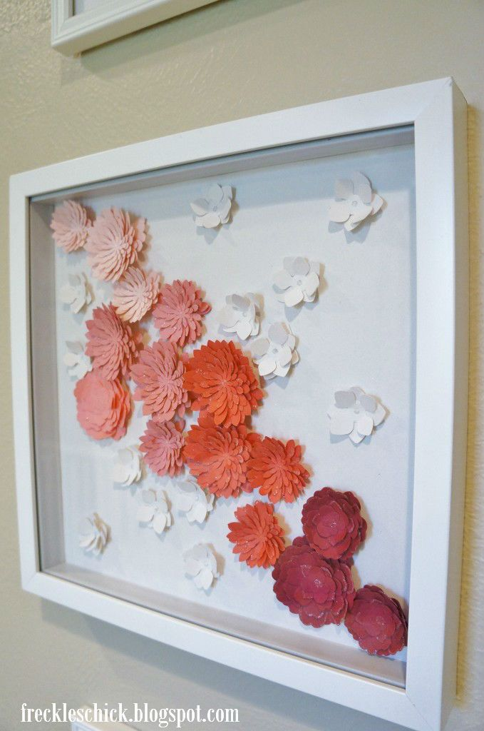 cloth flowers in shadow boxes. Love it but I don't think I could make that lol