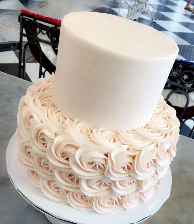 Two tier white and chiffon pink rosette cake