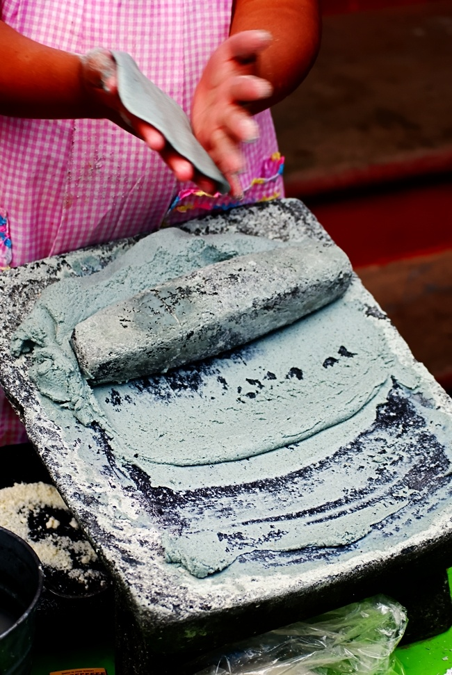Making tortillas the traditional Mayan way, by hand and with blue corn, Michoacan, Mexico.