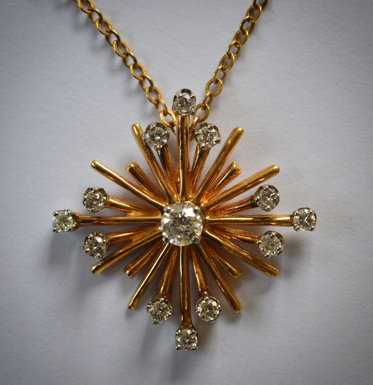 LOT 196: An attractive Continental star shaped pendant set in 14 carat gold on fine link chain. Approx. 9.5 grams. Est. £150 - £200. Hammer price: £280.
