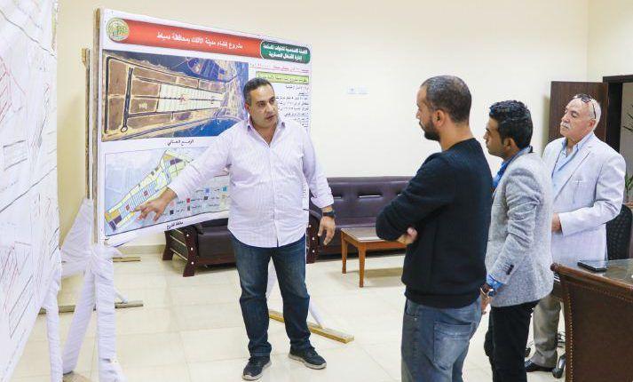 المهندس أحمد زلط القائم بالأعمال الهندسية ومدير مشروع مدينة دمياط للآثاث Lab Coat Fashion Coat