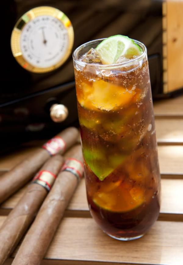 Cuba Libre: •2 oz. dark or golden rum •juice of ½ a lime •Coca-Cola •lime wedges for garnish