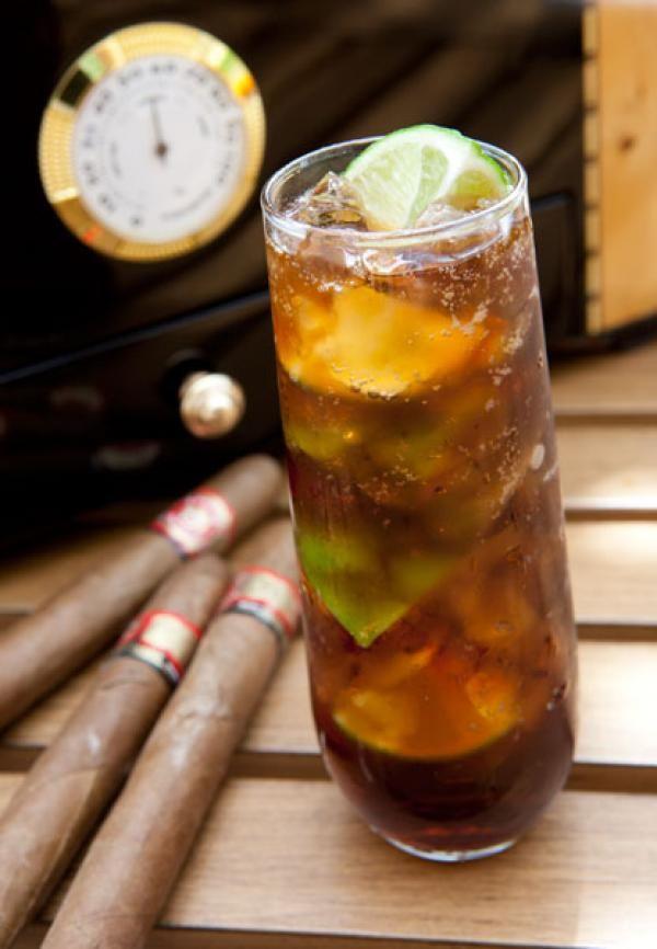 Cuba Libre: •2 oz. dark or golden rum •juice of ½ a lime •Coca-Cola •lime wedges for garnish