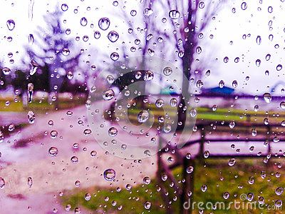 Background with window view in autumn season with water drops on the blue window