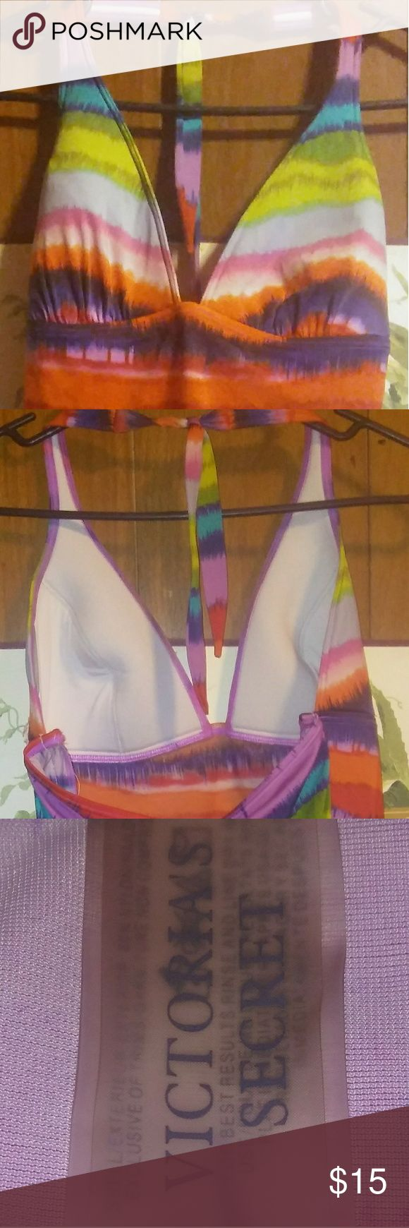 Victoria's Secret Swim Top This is a colorful VS swim top with a halter neckline. It is a tankini meaning it will stop at your waist or longer depending on your shape.  *BOTTOMS NOT INCLUDED* Victoria's Secret Swim