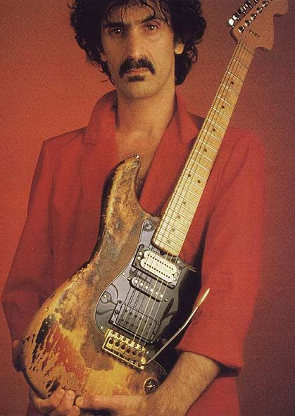 The Maestro, holding one of Jimi Hendrix' burned strats given to him by one of Jimi's roadies. The full story of this amazing piece can be found here: http://www.dweezilzappaworld.com/articles/10-the-jimi-hendrix-frank-zappa-strat