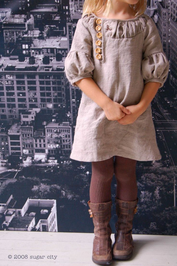 neutral dress, tights, boots.