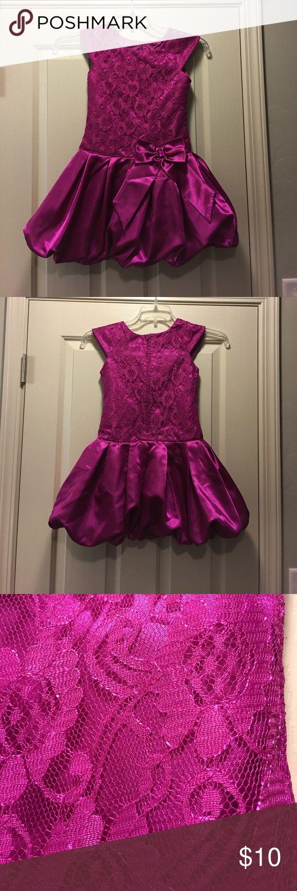 Little girl size 7 fancy hot pink dress Only worn a few times. It is in perfect shape! Size 7 in little girls. A hot pink color, maybe a bit maroon. Jona Michelle Dresses Formal
