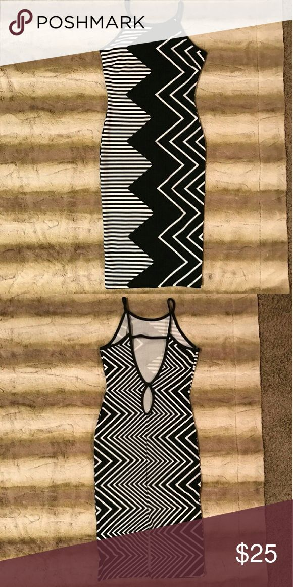 Ziz zag pattern bodycon dress Tight fitting bodycon black and white patterned stress with racer back feel spaghetti straps . Privy Dresses Midi