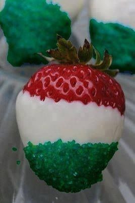 Strawberries dipped in white almond bark then in green jello!