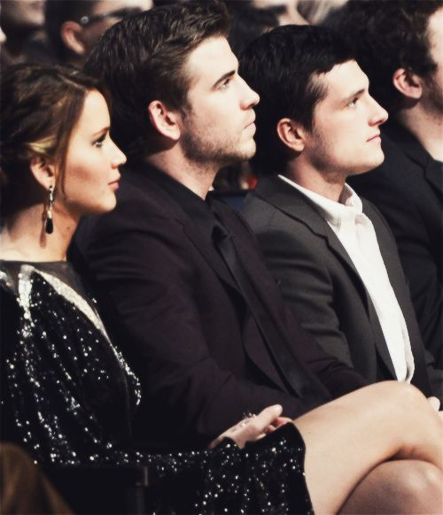 Jennifer Lawrence, Liam Hemsworth, and Josh Hutcherson sitting together at the 2013 People's Choice Awards held at Nokia Theatre L.A. Live on 01/09/12.