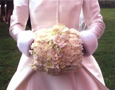 Muff bouquet. Muff is covered in pink flowers : )