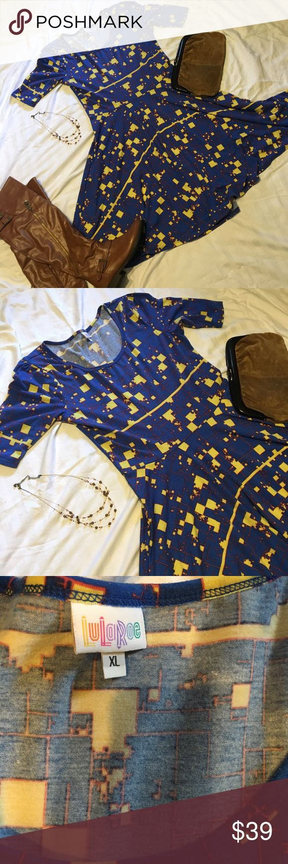Royal blue LLR Nicole EUC. Blue with yellow and maroon pattern. Super soft. Worna handful of times and always hung to dry. Matching boots, necklace, and vintage clutch also available from my closet! Make an offer! 30% off bundles of 2 or more! LuLaRoe Dresses