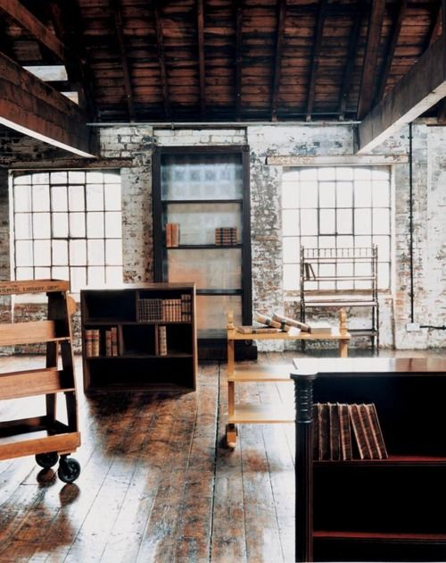 I love this space.... Brick and open beams are two of my favorite things!
