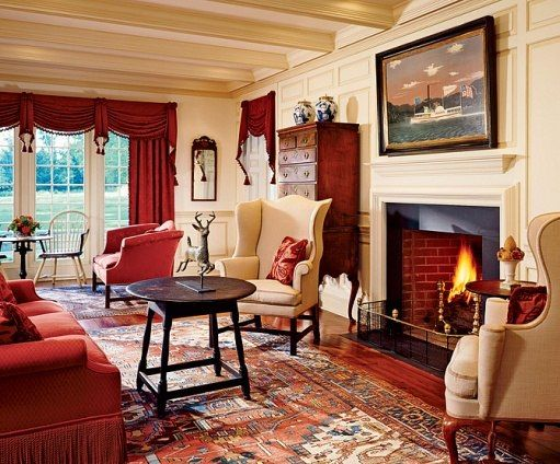 traditional 18th century living room The big cushion chairs, red and tan colors and defined rug on the floor refined rusticity!