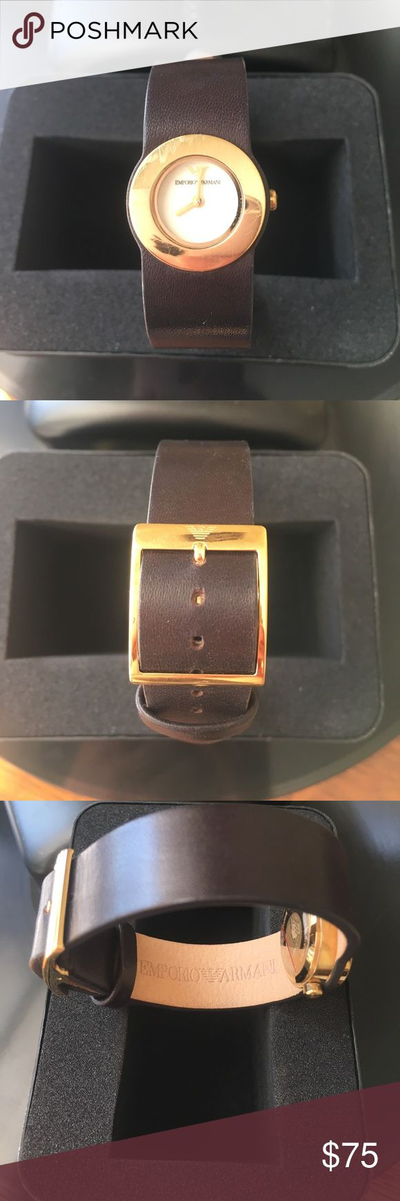 Emporio Armani Brown Leather Watch Ladies watch, comes in its original case. I'm petite and it fits me perfectly. It does need a battery but looks like a cute bracelet even if you don't replace the battery right away. Pretty dark brown leather with gold face and buckle. I paid $150 for it originally and only wore it a couple times. There is very minimal scratching on the gold around the face but only if you are looking very hard for it (see pics). Leather has no flaws. Let me know if you…