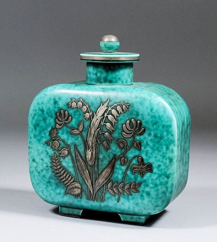 """A Gustavsberg """"Argenta"""" pottery jar and cover designed by Wilhelm Kage, applied with white metal design of wild flowers, 7.5ins high (printed factory marks and No. 1144"""