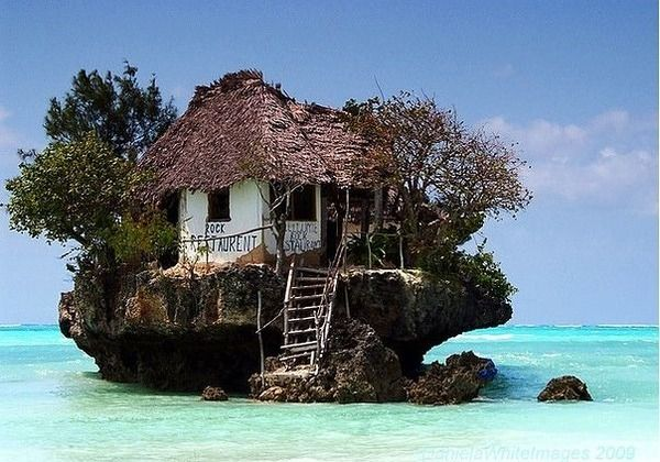 Restaurant on a cliff on the east coast of Zanzibar.Depending on the tide the restaurant can be reached both on foot and by boat.