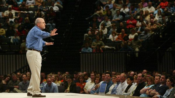 Financial adviser and radio personality Dave Ramsey tells the crowd to