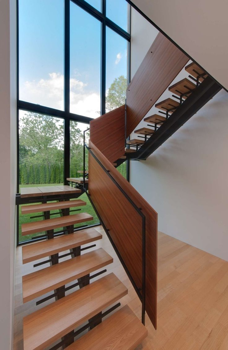 Minimalist contemporary home design in lovely appearance brilliant wooden staircase design nearby the high ceiling window at riggins house robert gurney