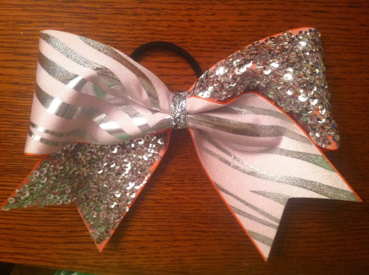 """3"""", 3 inch cheer cheerleader bow SILVER  sequins and zebra on ORANGE ribbon--Team Bows. $15.00, via Etsy."""
