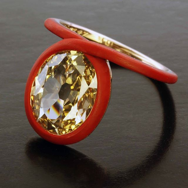 A ceramic take on a classic Taffin setting. 3 cts brown diamond ring.