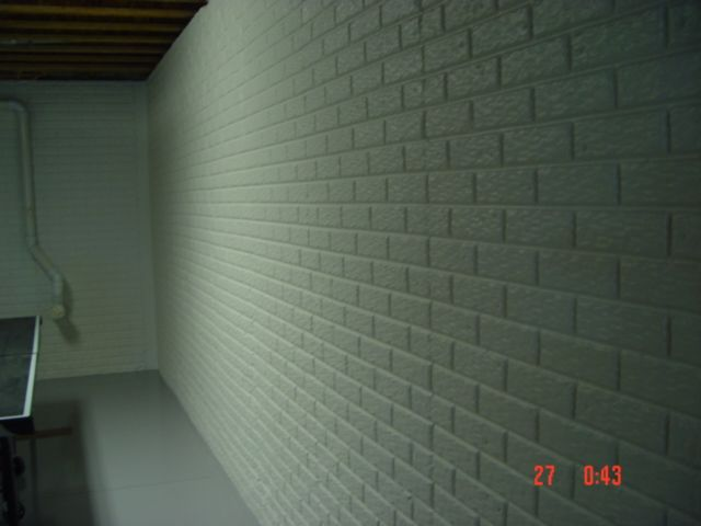 Painted basement wall poured concrete with brick pattern for Poured concrete basement walls