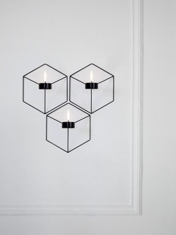 Suuuuper cooooool POV candle holder by Note Design Studio. It looks like a cube from straight on, but is actually kind of a pyramid shape.