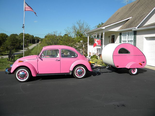 a pink bug and tear drop, how celebritys sport cars sport cars