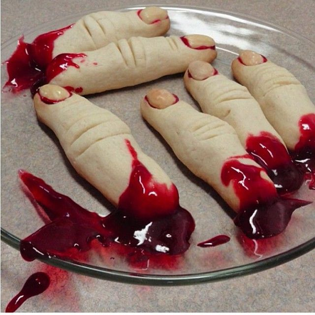 "Halloween: Roll sugar cookie dough in shapes of fingers, make marks for knuckles and make indentation for fingernail. Bake as directed for cookie dough. ""glue"" almond slices with cherry/strawberry pie sauce for fingernails. Garnish with pie filling for ""gore"""