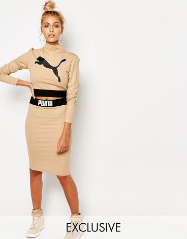 Camel bodycon skirt co ord by PUMA. Midi skirt by Puma Stretch knit High rise Branded waist Close cut body-conscious fit Machine wash...