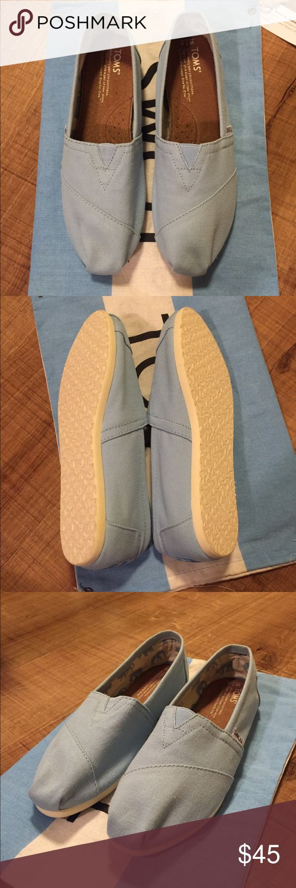 New unworn baby blue TOMS Baby blue toms, that are new and unworn TOMS Shoes Flats & Loafers