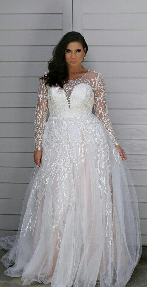 All in this plus size wedding gown is about that unique lace and super flattering shape. Rainy. Studio Levana. 2018