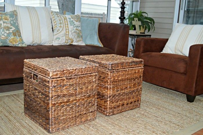 There is not enough space for a coffee table (or the thought terrifies you because you have small children running around).  Do invest in storage cubes, bins, or baskets that can double as a coffee table.  (Bonus, it hides toys.) Look for ones that can easily be moved around for play time and also provide extra seating for company.