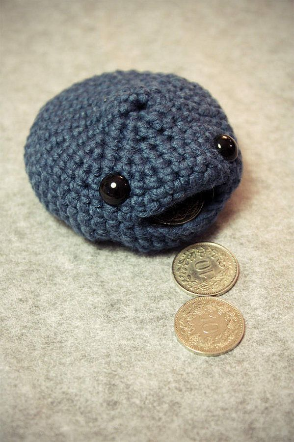 Amigurumi coin purse. It's knitted, but would like to try converting to crochet. No pattern with this one. If I figure this out, I'll see if I can post it. Cute, cute!