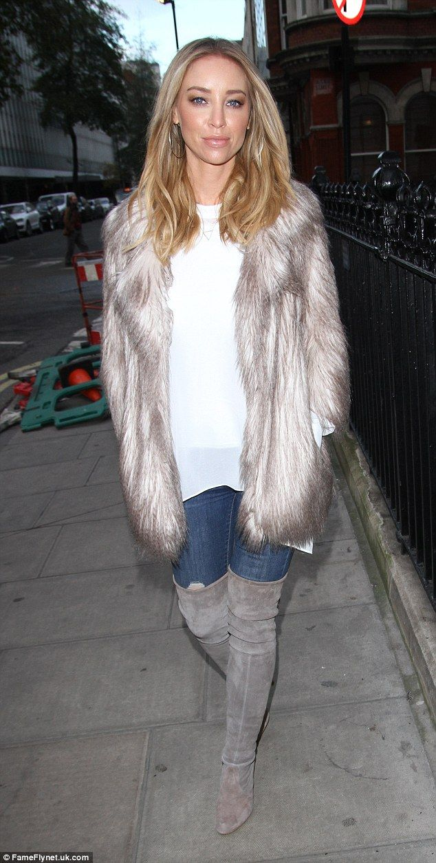 Fur-tastic: Lauren Pope nailed winter dressing in a fashionable grey coat and suede thigh-high boots as she enjoyed a late lunch at Berners Tavern in London on Sunday afternoon