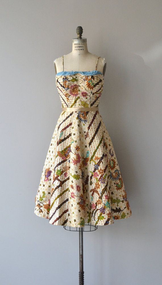 Vintage 1950s cotton batik fabric sun dress with baby blue rhinestone studded and center ruched bodice, corset boning, fitted waist, full skirt with