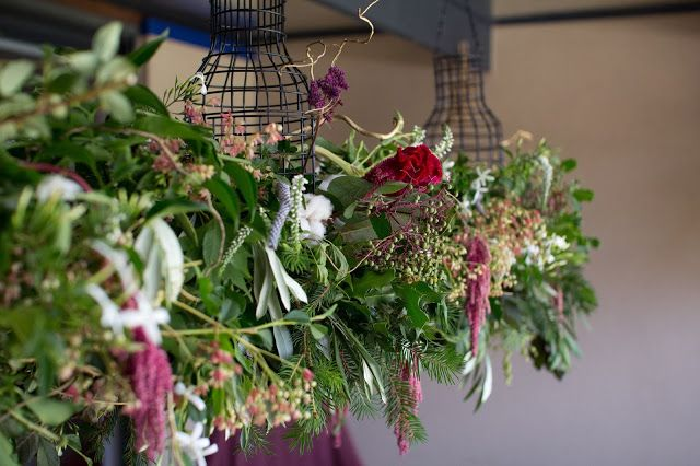 Naomi Rose Floral Design | Bohemian styled Christmas flowers | Red | Cotton flower | Green Rose | Suspended Garland | Hanging Flowers | Holly